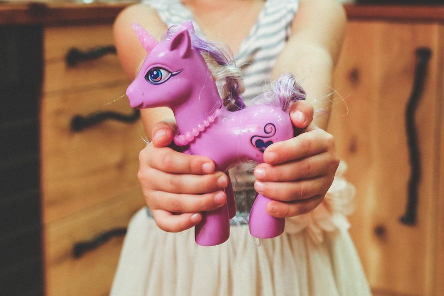 1-hands-purple-child-holding-large